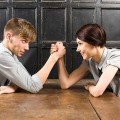 Young couple arm wrestling