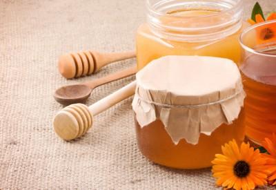 honey, flowers and honey in glass po